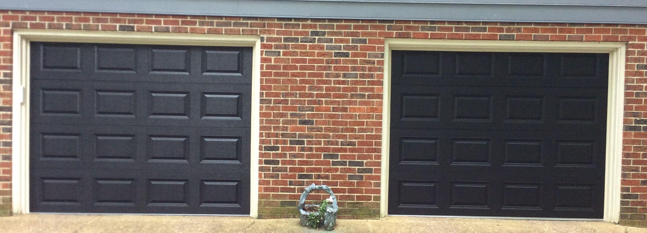 Two 9x7 Model 2216 Black Double Sided Steel Garage Doors Installed
