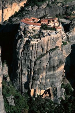 """Medieval monastery in Greece at Meteora--the name means """"suspended in midair""""--on prongs of rock towering hundreds of feet above the plain of Thessaly."""