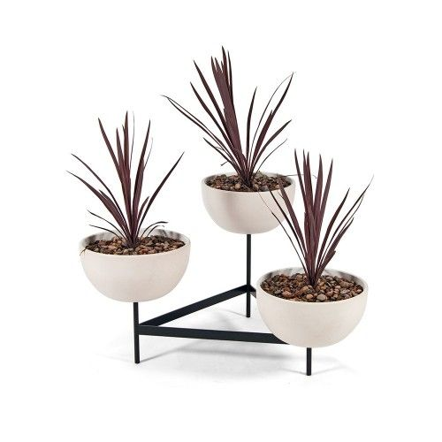 The ceramic bowls with metal tri-stand planter was originally designed during the post-WW2 architecture and design period. Available at the Dwell Store: store.dwell.com