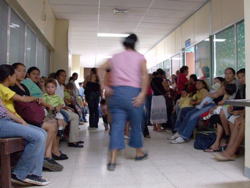 A crammed waiting room in the pediatric ward. Description