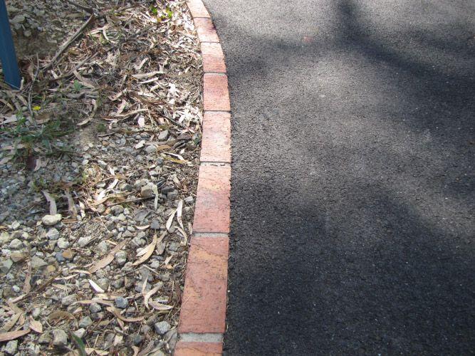 Asphalt Driveway Cost Calculator Get An Instant Quote Driveway Edging Asphalt Driveway Brick Edging