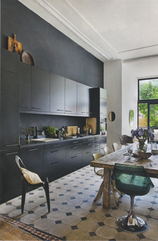 Im really embracing the dark side of kitchens at the moment this inky kitchen cabinets and traditional tiled floor contrast beautifully with the mismatched