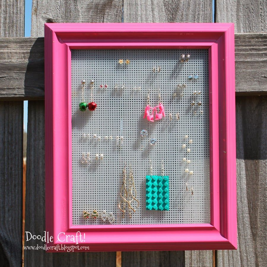 Earring Holder Picture Frame!  Use a frame and plastic canvas for the perfect way to display earrings!