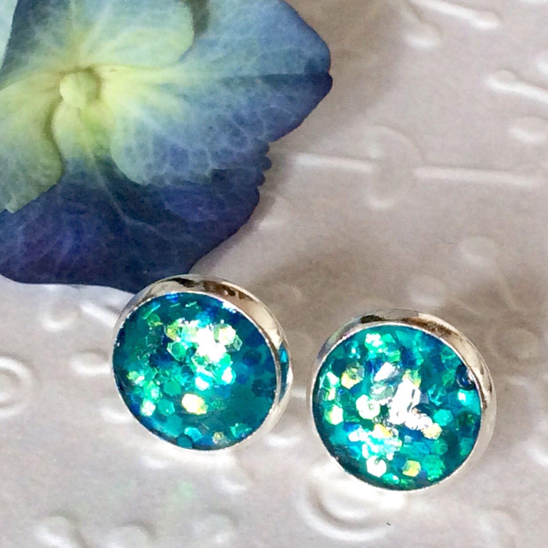 Stud earrings,Round Emerald sparkly resin stud silver plated post earrings,glitter earrings,resin stud,glitter stud,sparkly stud earrings by skietromart on Etsy https://www.etsy.com/listing/226839994/stud-earringsround-emerald-sparkly-resin