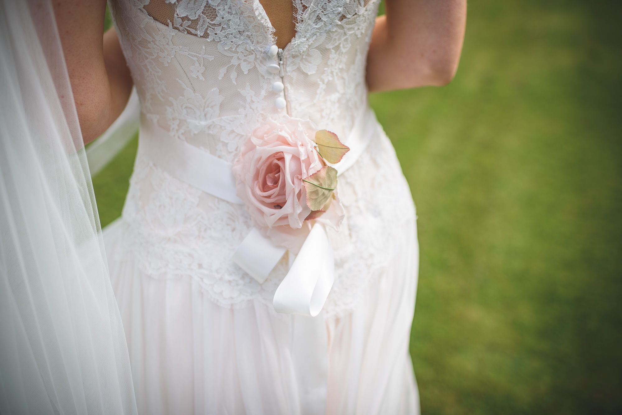 Naomi Neoh Real Bride Rozie Wearing Our Signature Blush Pink Rose On The Back Of Her
