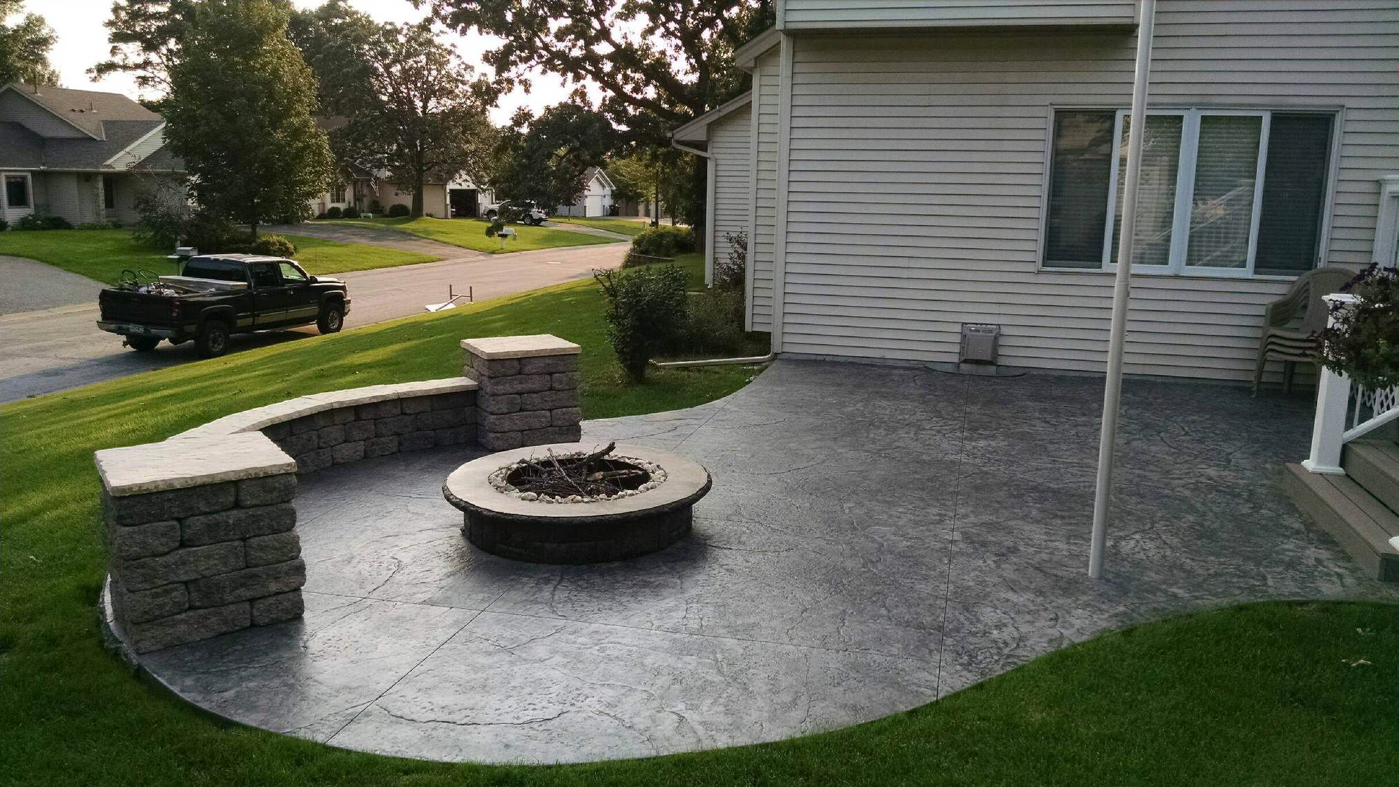 Stamped Concrete Patio With Fire Pit And Seating Walls By