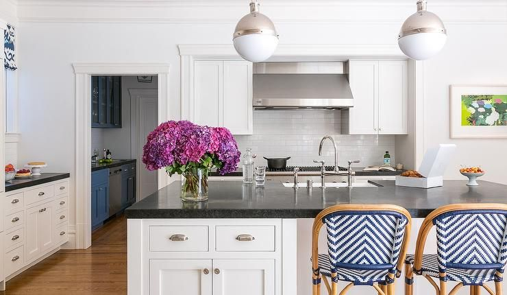 Serena Lily Chevron Riviera Stools Displayed At A White Kitchen Island Topped With Black Qua Shaker Style Cabinets Shaker Style Cabinet Doors Kitchen Remodel