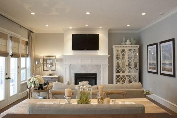 wohnzimmer mit wandgestaltung in grau une einem luxus kamin - wohnzimmer ideen kamin