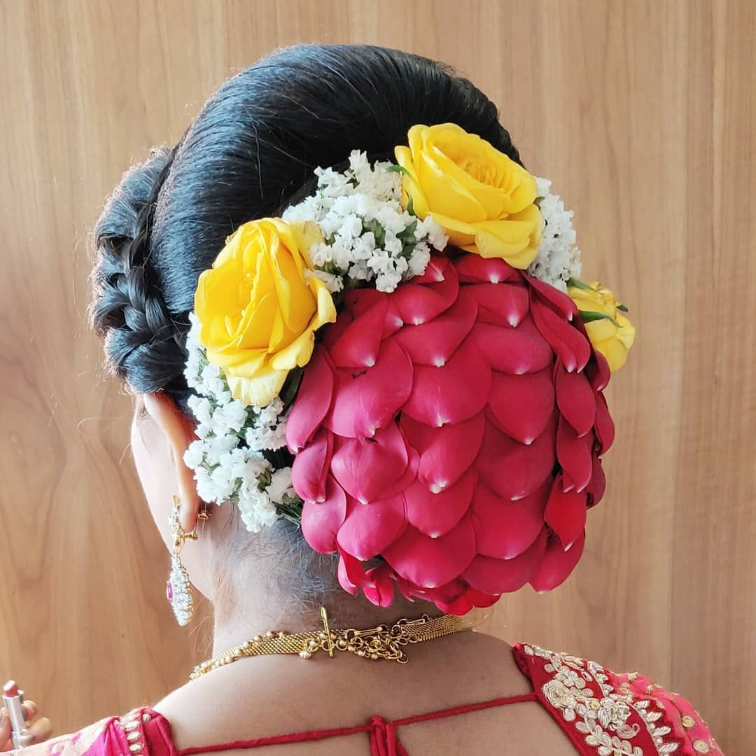 What A Beautiful Large Low Bun Covered With Rose Petals Care However Should Be Taken Before A Bridal Hair Decorations Hair Decorations Bridal Hair Inspiration
