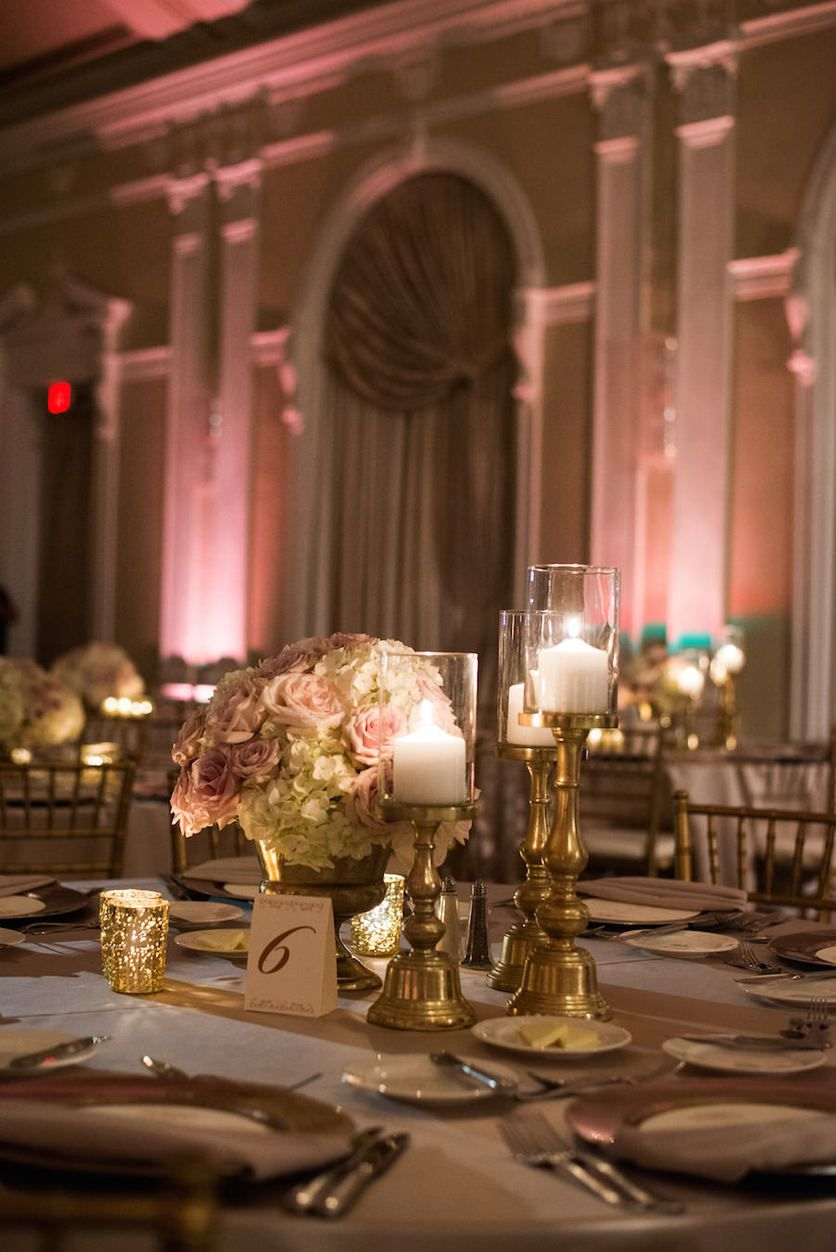 Wedding reception table decor with ivory and blush floral