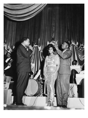 """It's true! Aretha Franklin really IS the Queen of Soul! She was """"officially"""" crowned just before a performance at the Regal Theater in Chicago in May 1964. Photo: Isaac Sutton for EBONY."""