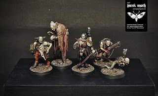 Toycutter: Warhammer 40K Inquisitor and Retinue.