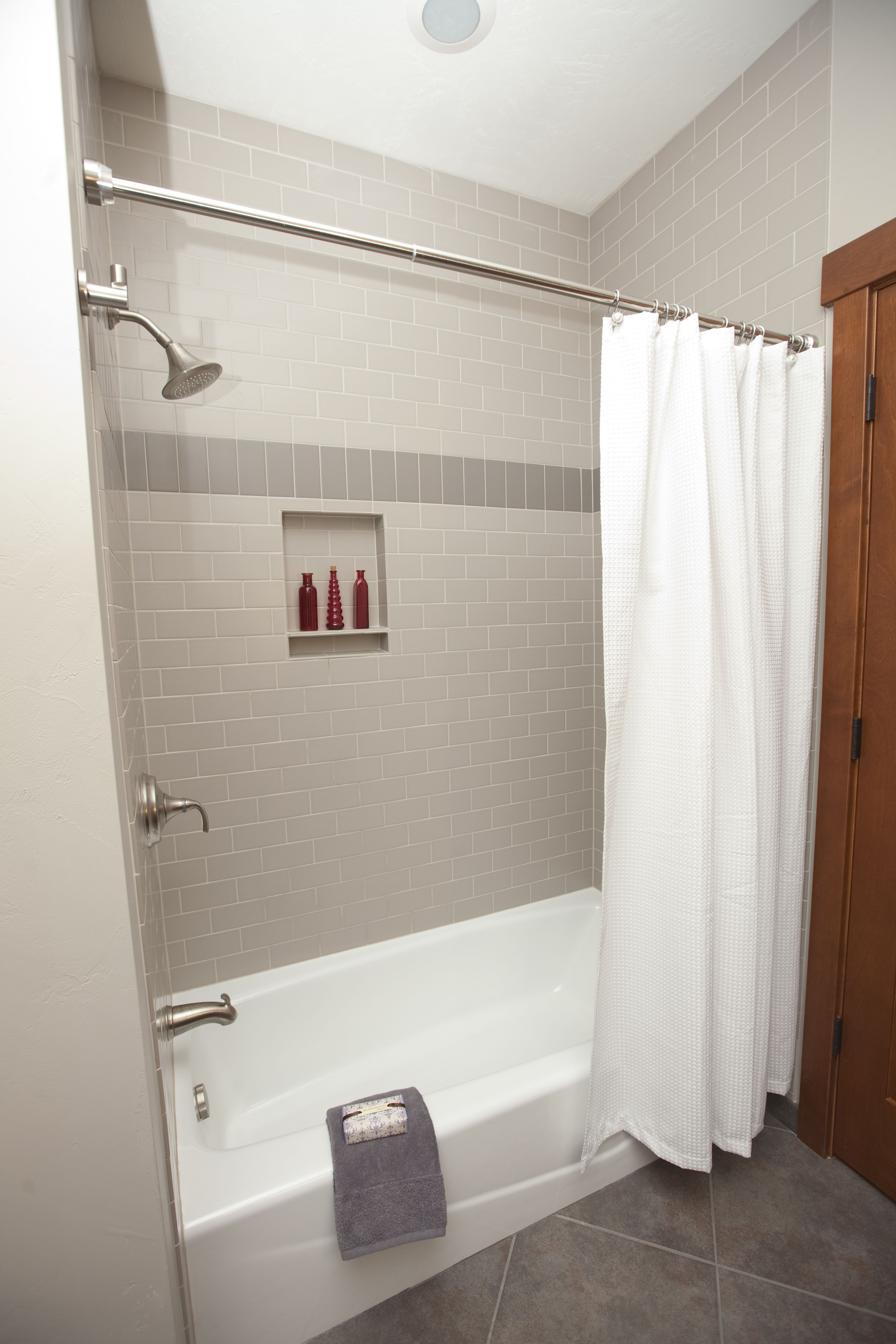 Classic Subway Tile In A Matte Finish Is Dressed Up Nicely By A Course Of Soldiers Standing At Classic Bathroom Classic Bathroom Design Classic Bathroom Tile