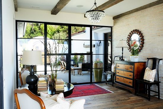 This inviting home features memorable windows by CA-based Euroline Steel Windows. #windows #interiordesign #livingroom #steel See more: http://bit.ly/1i0SWf6