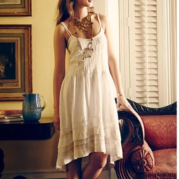 d.RA Danthonia Dress  Worn only once with absolutely no flaws! Does not come with slip featured in photos, so there is not a double strap. A favorite summer staple that has a carefree femininity that embodies the coming season. Beautifully detailed cotton slip dress with easy pullover styling and adjustable straps. Hand wash. Anthropologie Dresses Midi