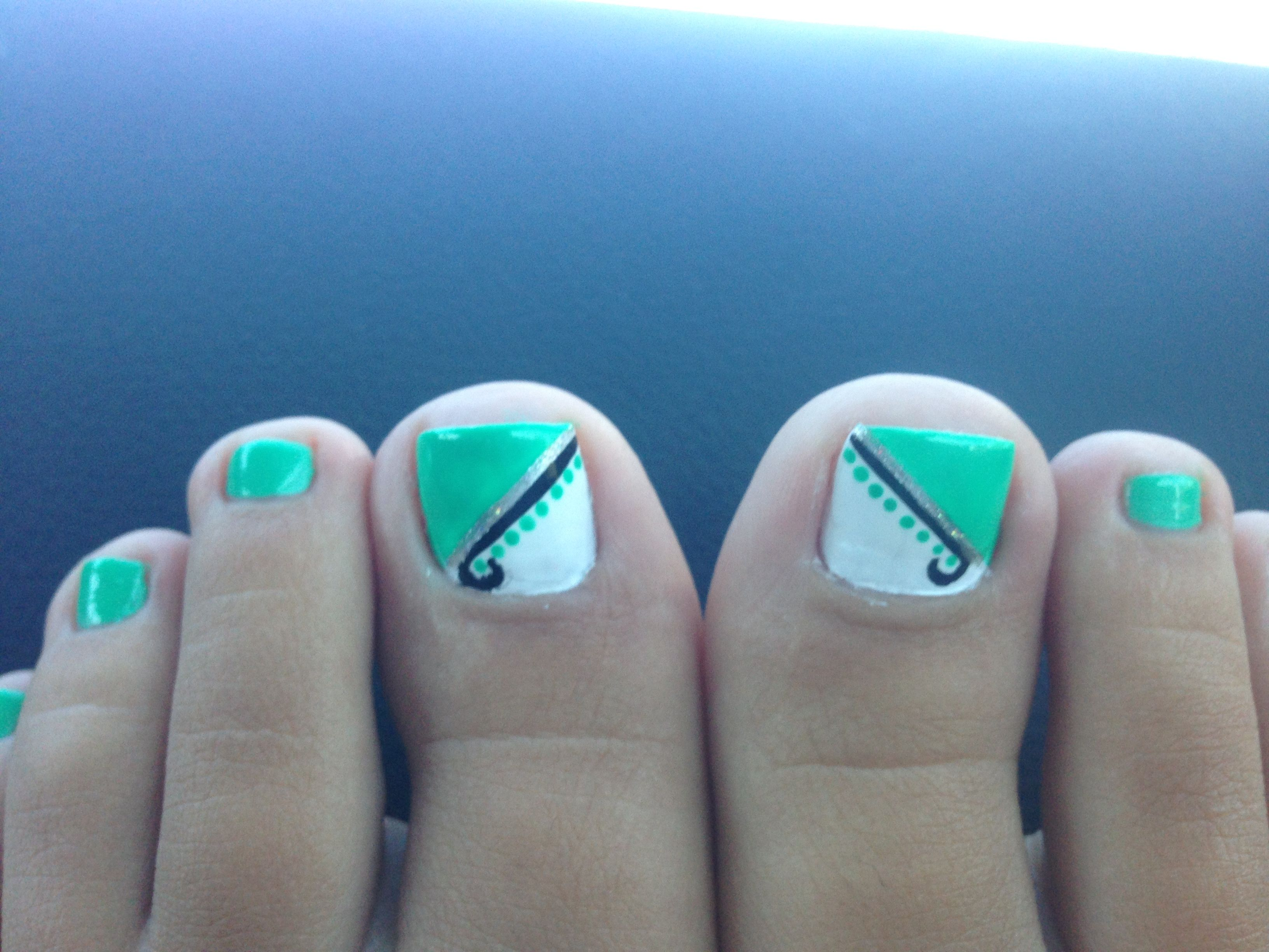 Mint Green And White With Black And Silver Line Toe Nail Design