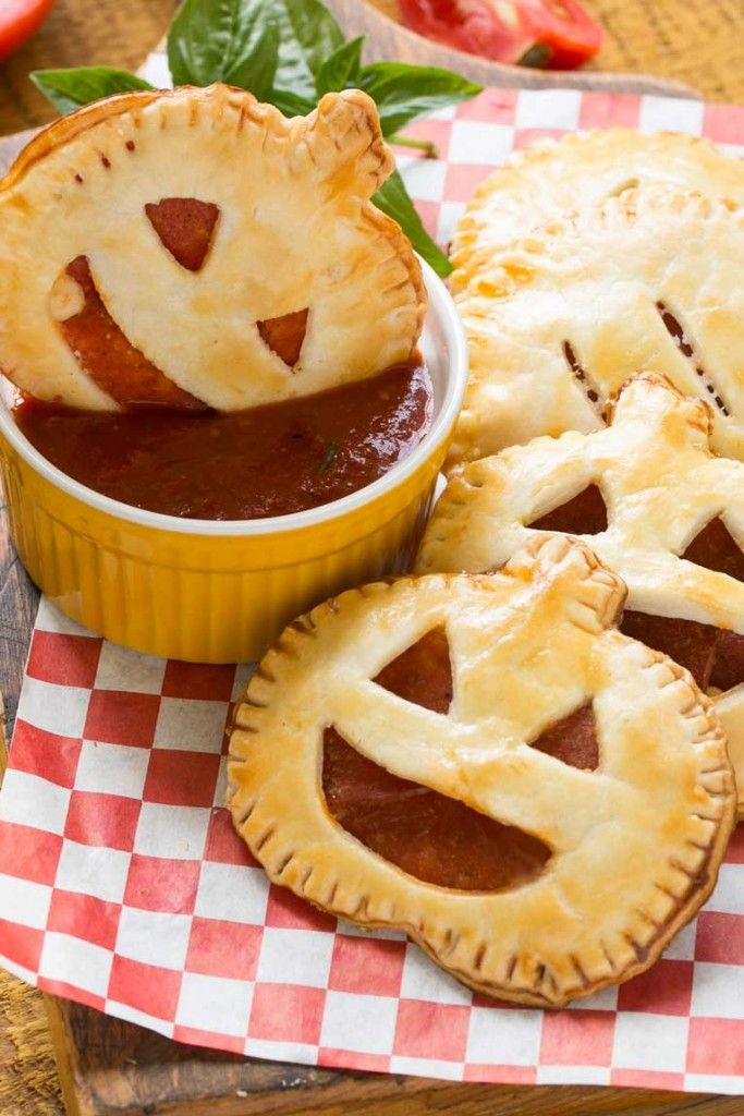 who needs candy when you can have savory halloween themed treats like these pepperoni pizza pumpkin pockets