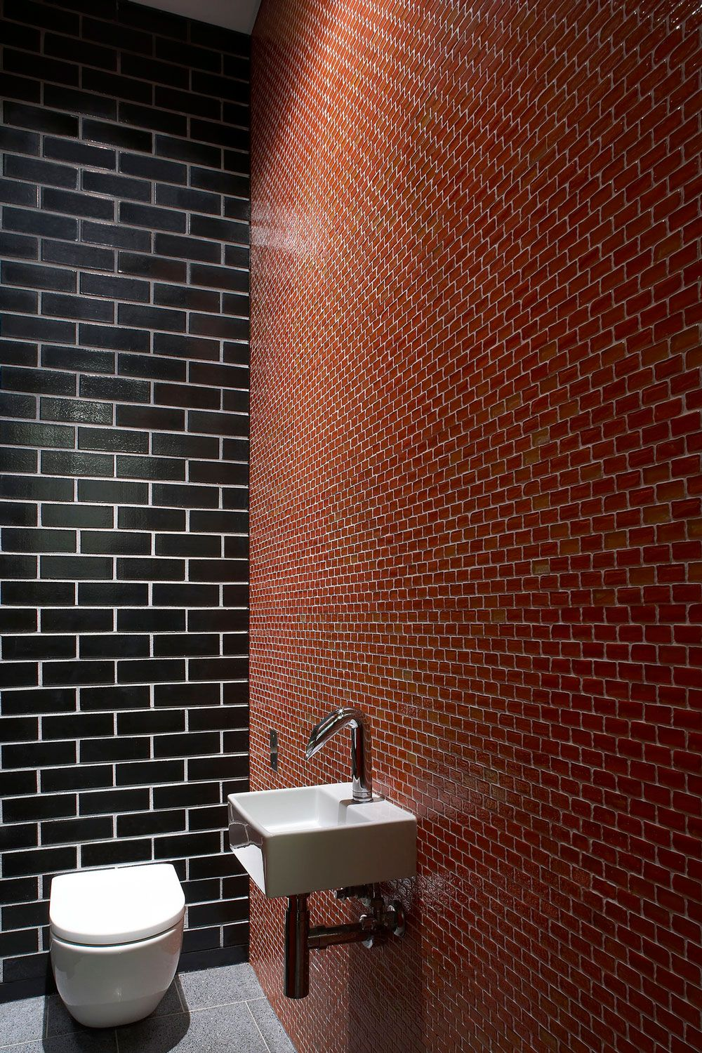 Architecture White Washbasin On Red Brick Wall Finishing With Black
