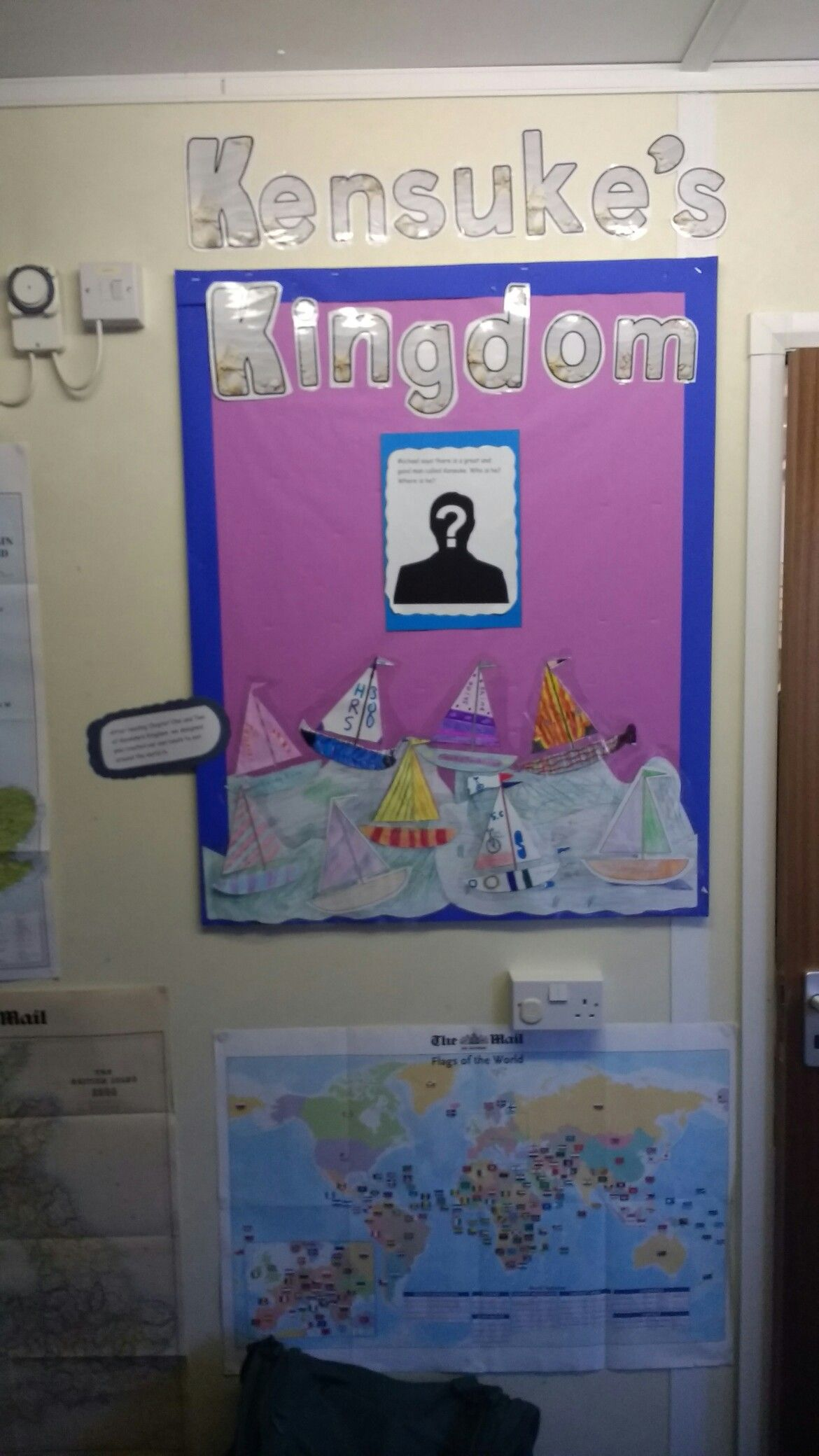 beginning of a Kensuke's Kingdom display. The question mark head will be replaced by a map of the island as the term continues. More will be added around the board also.