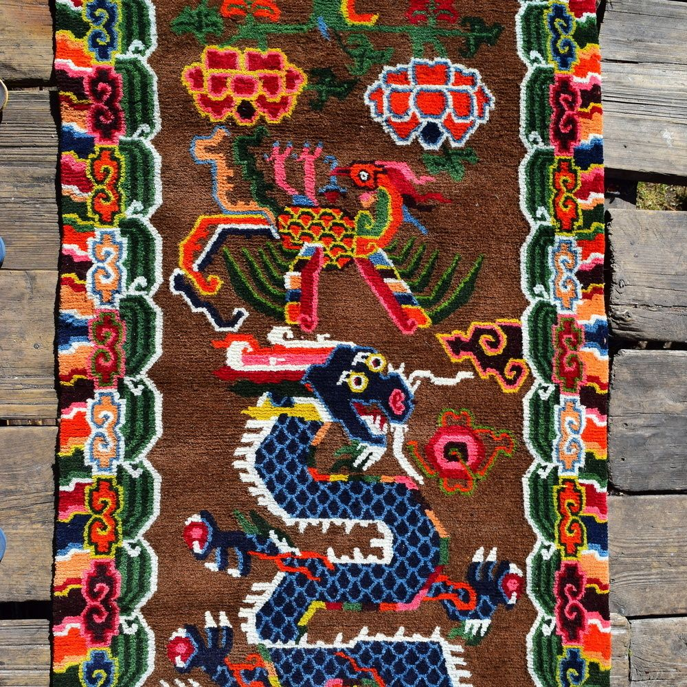 A Beautiful Contemporary Tibetan Hand Knotted Rug Showing A Flying Dragon  And Phoenix Withing A Traditional