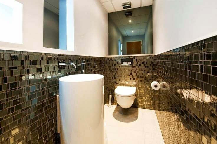 Half bathroom designs - This design is great as a guest bathroom with dark tiles on walls, two half mirrors. Also a unique white sink with a single foot.