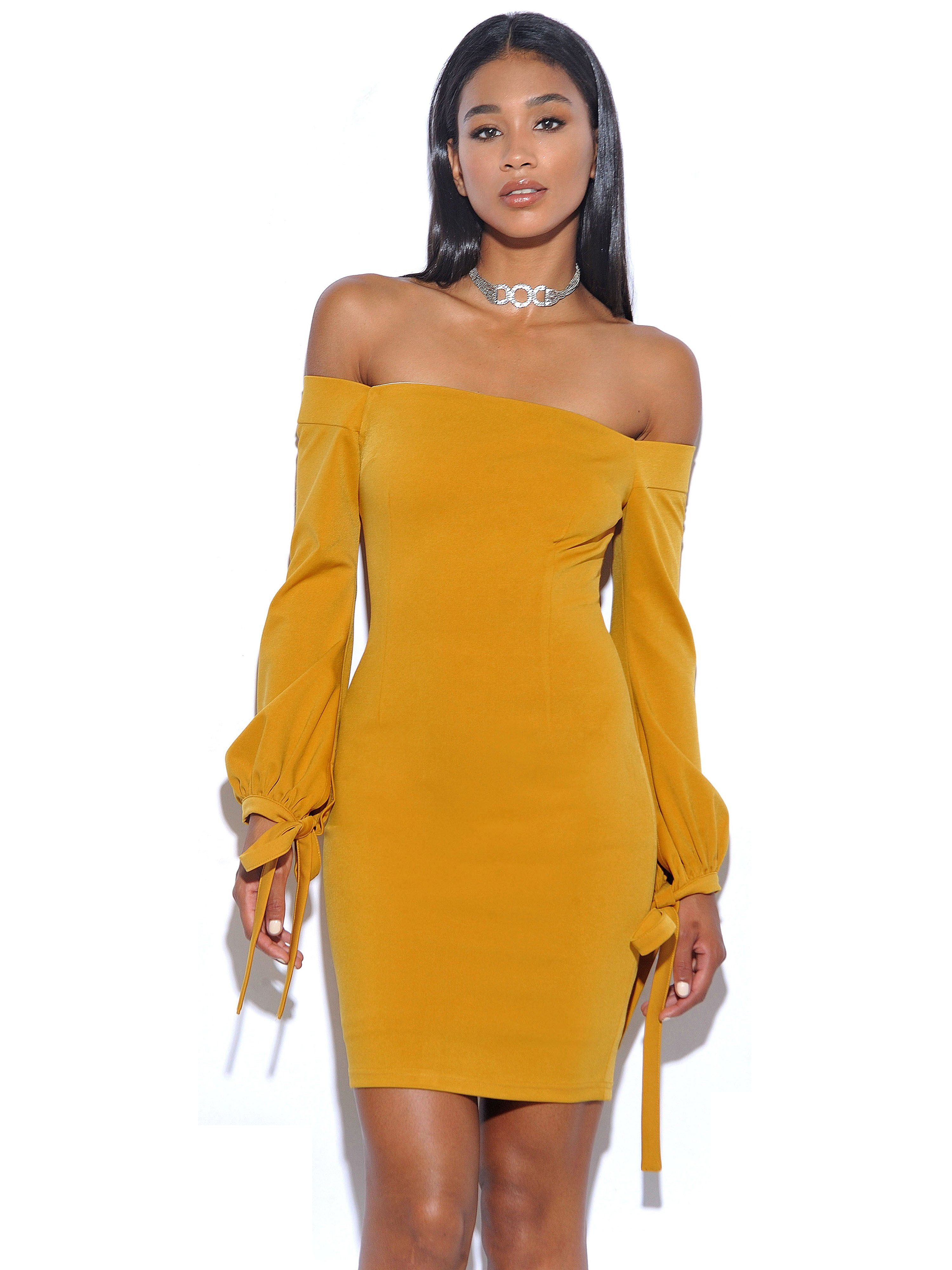 400a654b749d The Paloma bodycon dress features puffy tie sleeves leading up to a  gorgeous off the shoulder fully lined style to really stand out in the  crowd.