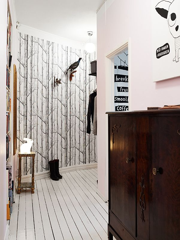 I love this wallpaper. The floor boards are cool too. And i love all the art and birds.