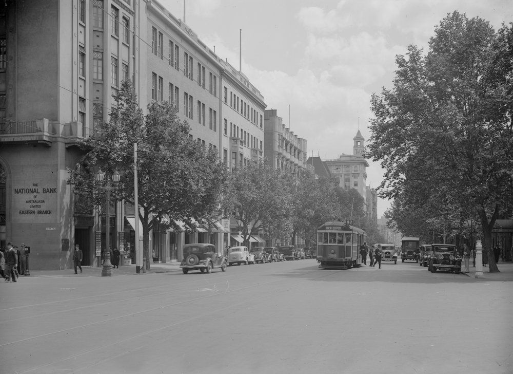 Collins Street, Melbourne, looking west between Exhibition and Russell Streets, c1950. Photograph from State Library Victoria / Victorian Railways.