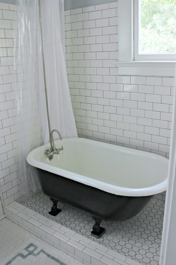 Clawfoot tub with tile surround like this idea but not for Clawfoot tub in small bathroom