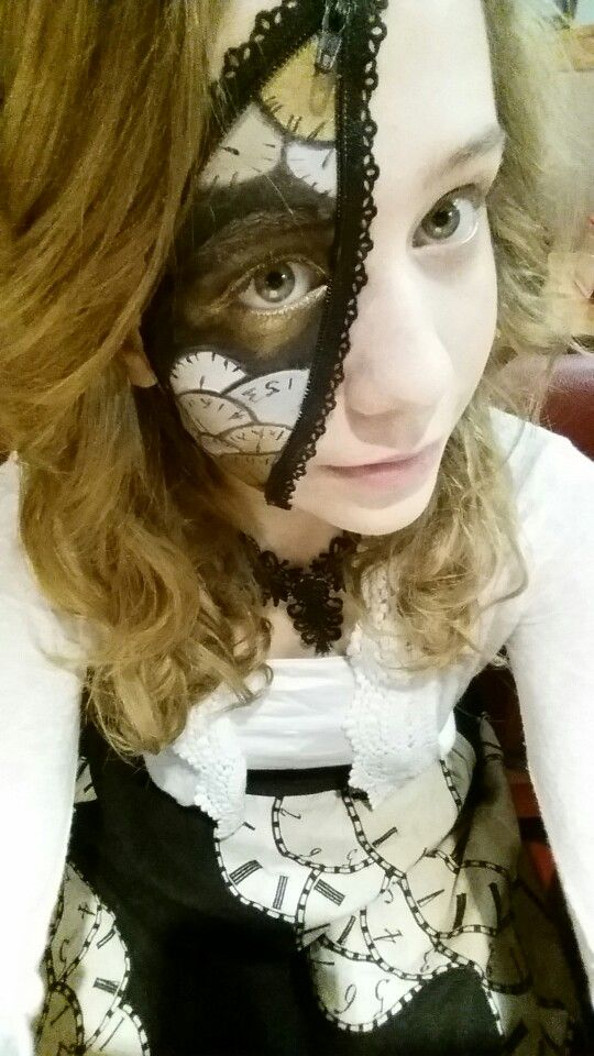 Feather Punk clockwork costume. 20's style clock skirt matching unzipped face makeup.