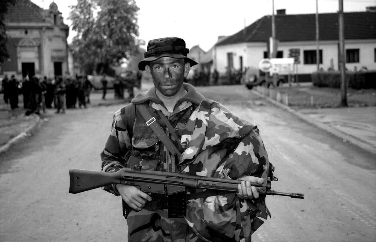"""Member of the Croatian 7th Brigade """"Puma"""" with his G3 automatic rifle during Operation Storm, 1995."""