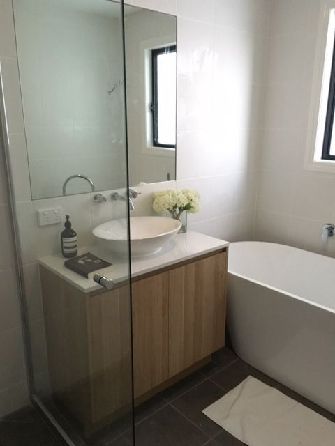 Guest bathroom with White Stone Benchtop, Polytec Natural Oak revine