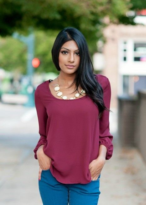 maroon and zippers blouse with scooped neck.