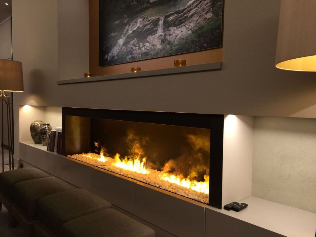 wall fireplace with tv yellow pattern fabric vertical curtain