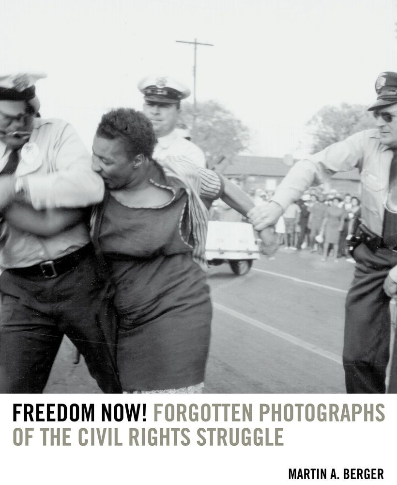 Unidentified Woman Bites A Policeman During A Protest Against