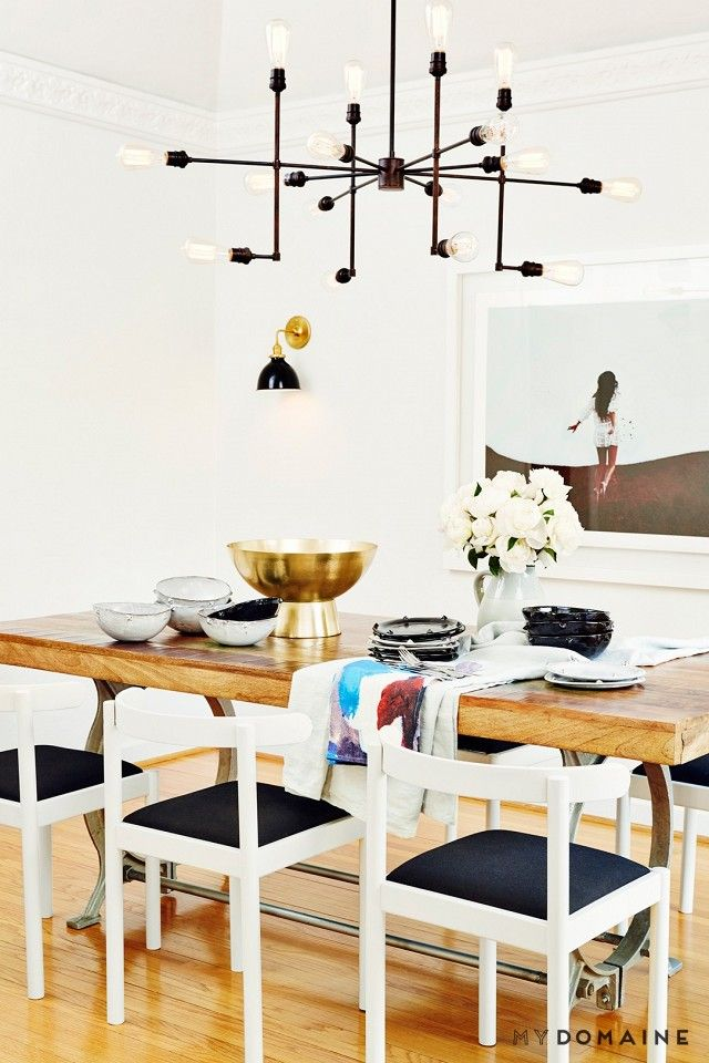 Bungalow Chandelier Part - 30: Dinning Room With A Large Chandelier, A Photograph, And A Kelly Wearstler  Dinning Set