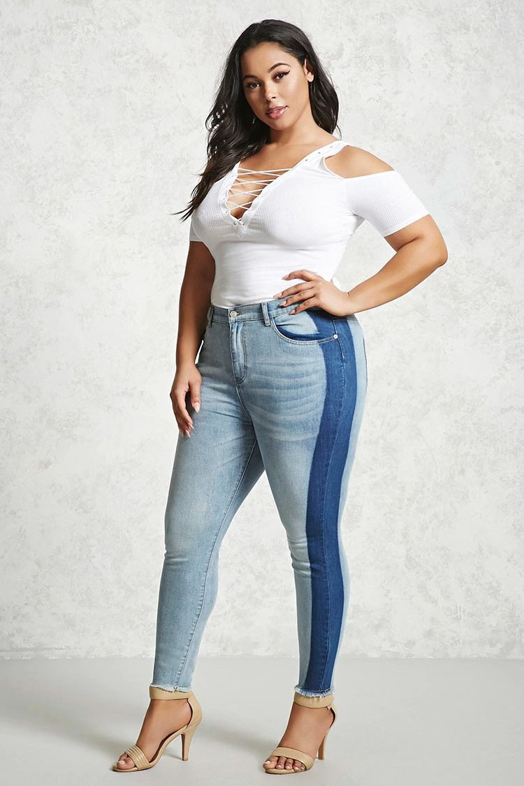6157ac9b35b Forever 21+ - A pair of skinny jeans featuring a two-toned colorblocked  design