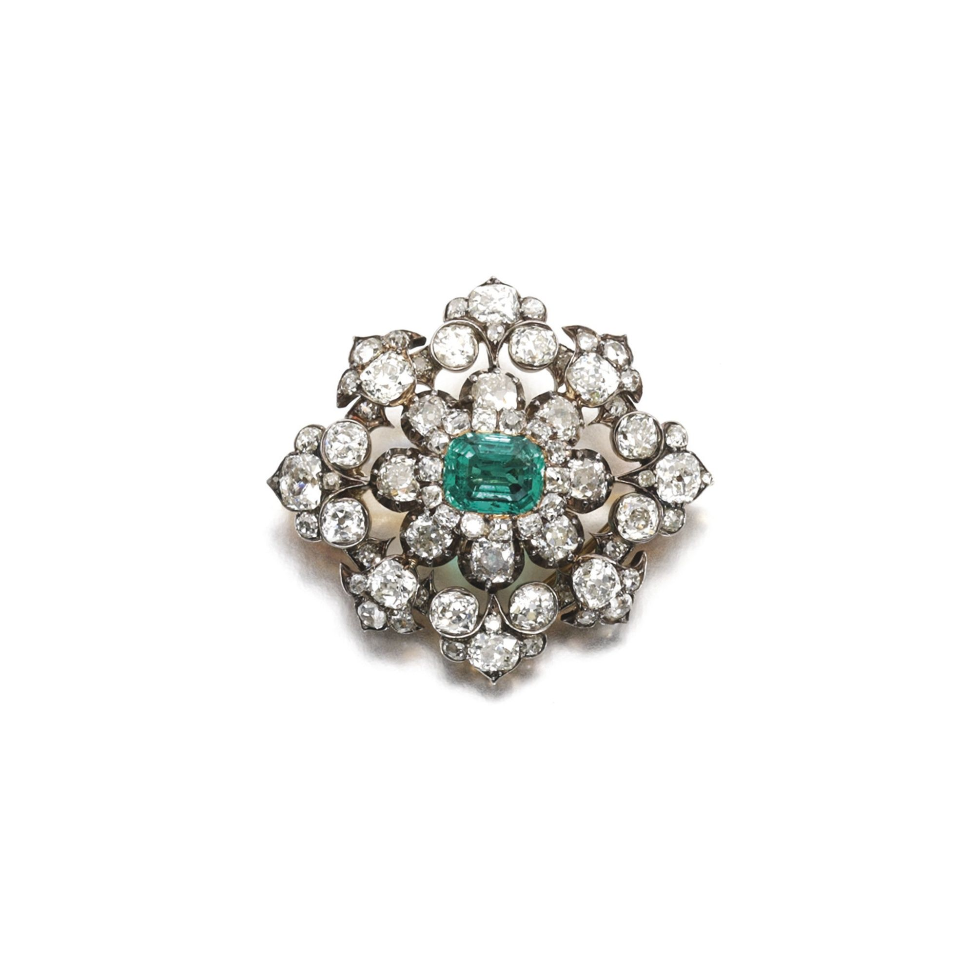 Emerald and diamond brooch of floral design clawset with an