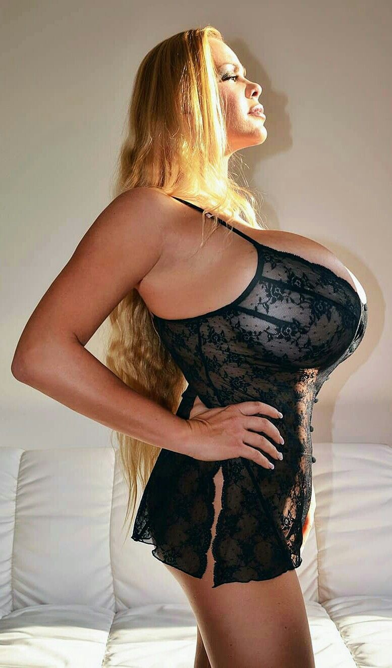 0d3894b7ba544 Fantastic blonde beauty with huge breasts in a tight cleavage revealing bra.  Santa Cruz