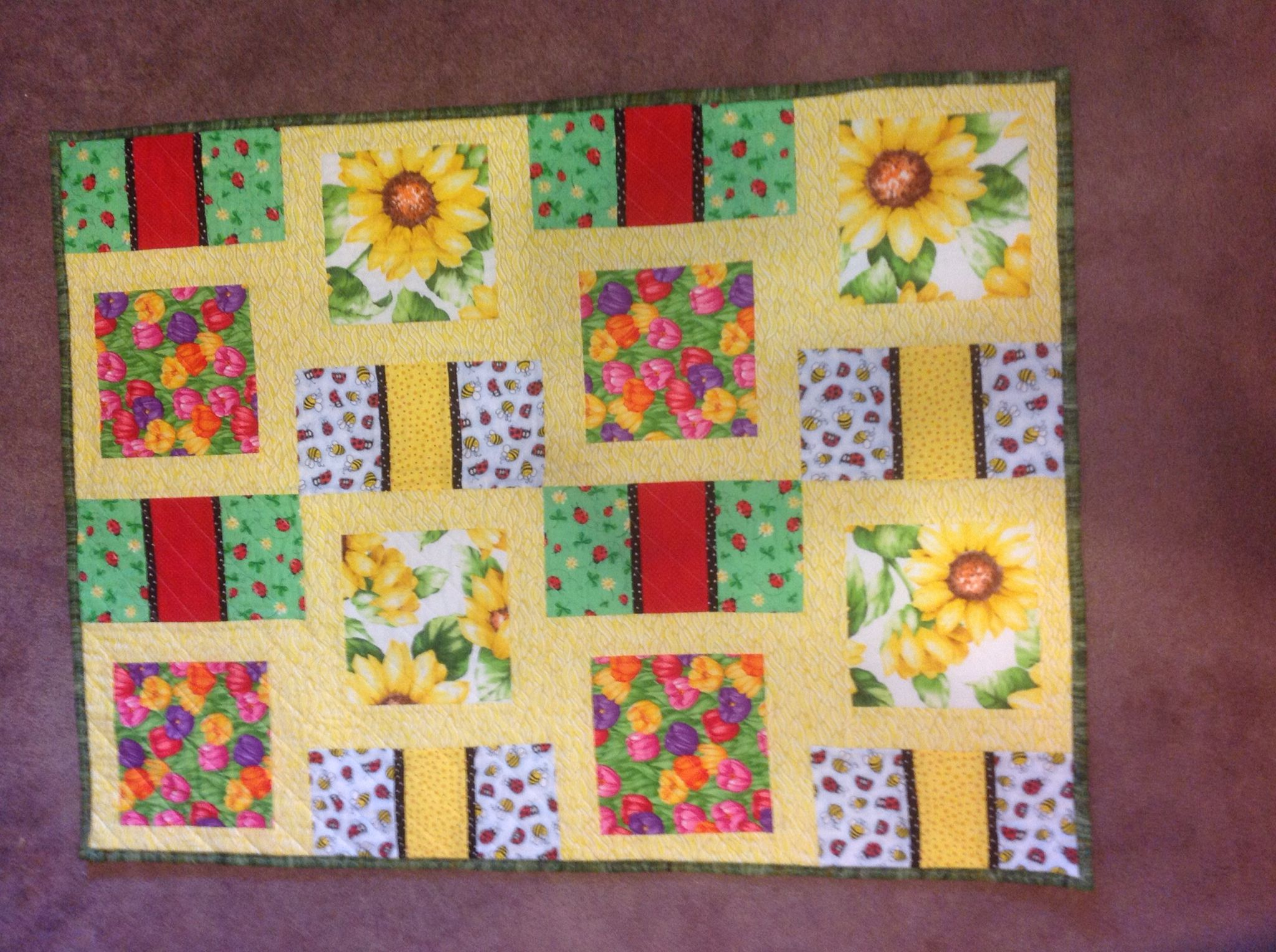 Sunflower, bees, and ladybug quilt