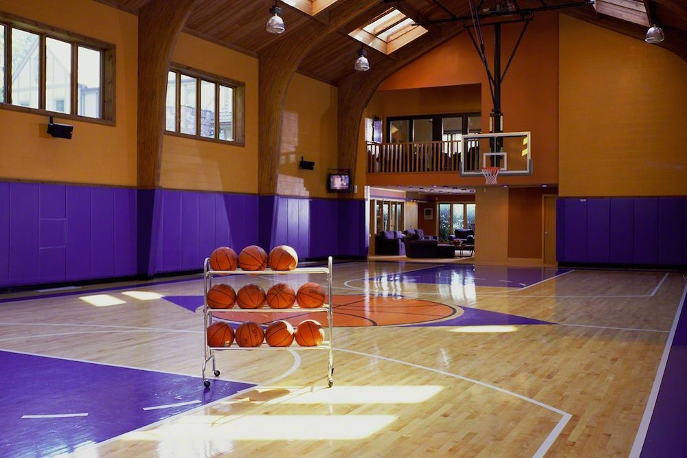 March Madness 16 Homes For Sale With Basketball Courts Home Basketball Court Indoor Basketball Court Indoor Basketball