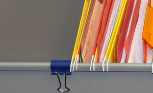 Use binder clips to keep hanging files from sliding forward when you open the drawers.  Very smart!