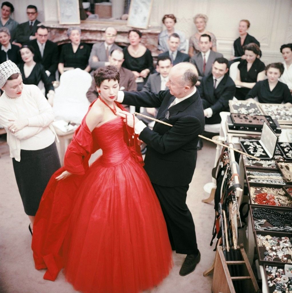 Christian Dior fitting a model in his salon, 1954