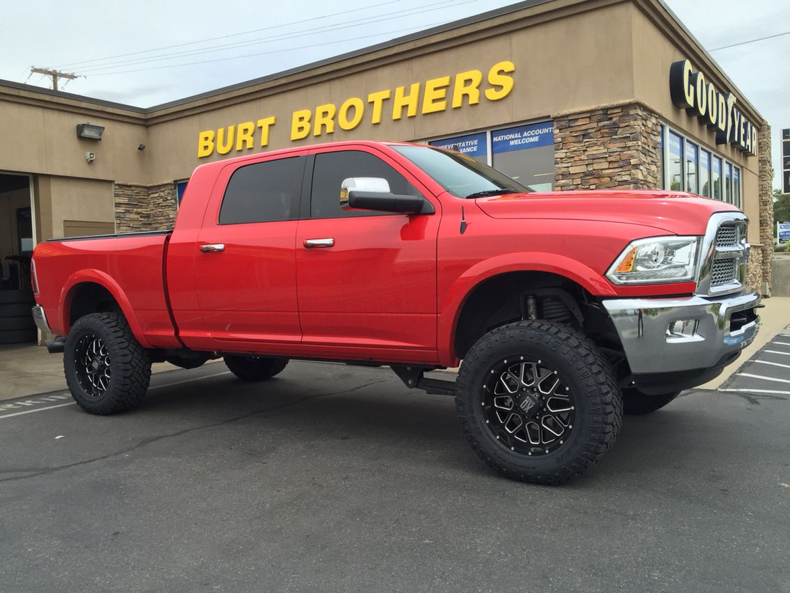 2014 ram 2500 mega cab with xd grenade wheels and 325 60r20 goodyear wrangler duratrac s