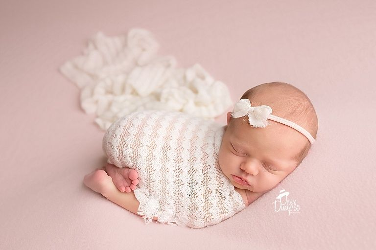 One dimple photography dallas fort worth newborn photographer tushie up pose pink and cream