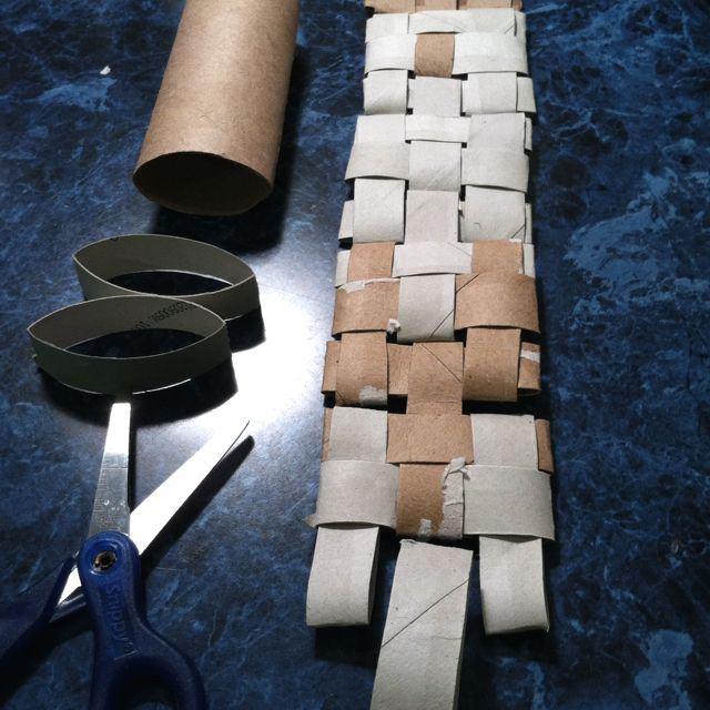 Woven toilet paper tubes.  Cut each flattened tube into six equal parts and weave as you see here.
