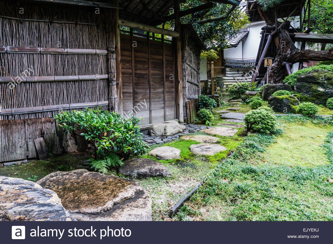 Stock Photo   View Of A Traditional Japanese Garden With Old Bamboo Fence  And Stone Path In Kyoto, Japan