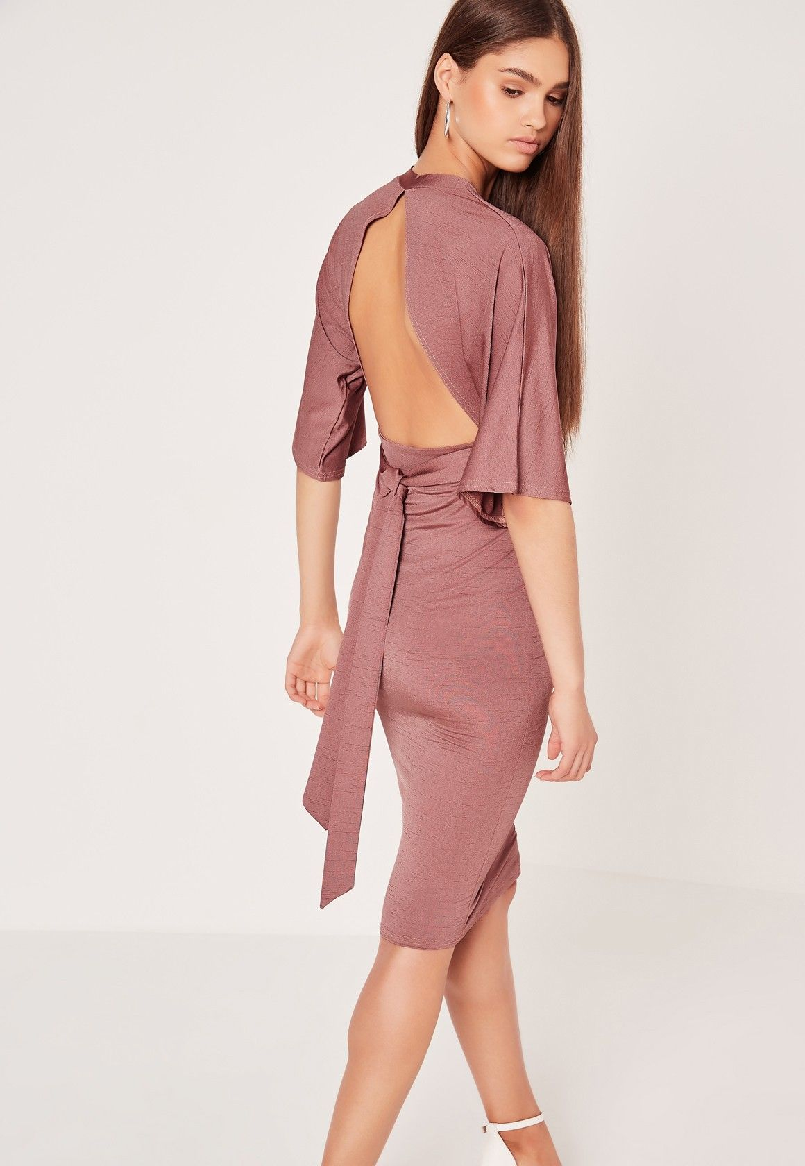 We're getting our romantic eyes on for this weekend in this midi. Featuring a burnt rose pink hue, sexy plunge neckline with floaty kimono sleeves, open back and a sophis' midi style, we're teaming with barely there heels and a basic clutch...