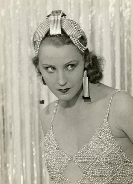 Brigitte Helm wearing jewels by Raymond Templier for her role as La Baronne Sandorf in Marcel l'Herbier's 1928 film L'Argent. Description from pinterest.com. I searched for this on bing.com/images