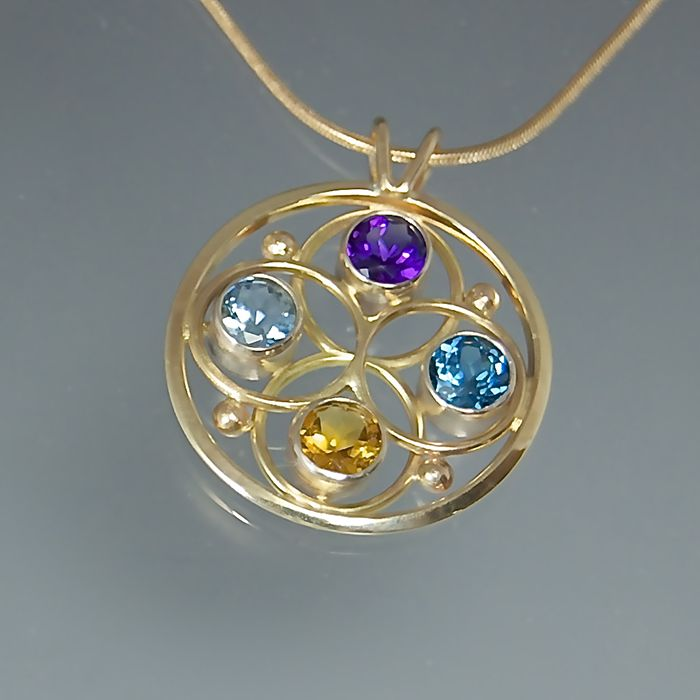 Birthstone pendant wish list pinterest susan panciera mothers birthstone pendant with amethyst blue topaz citrine aquamarine aloadofball Images
